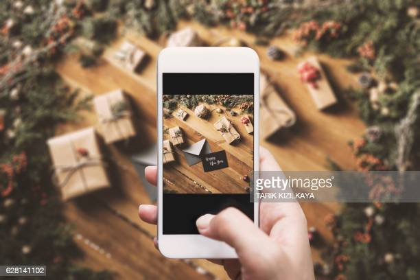 Hand photographing Happy New Year table top flat lay