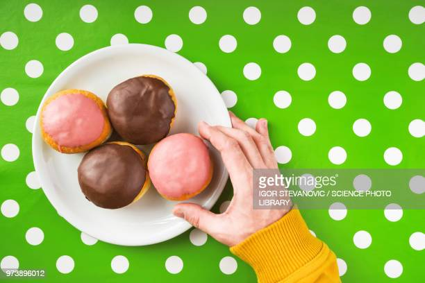 Hand picking donut