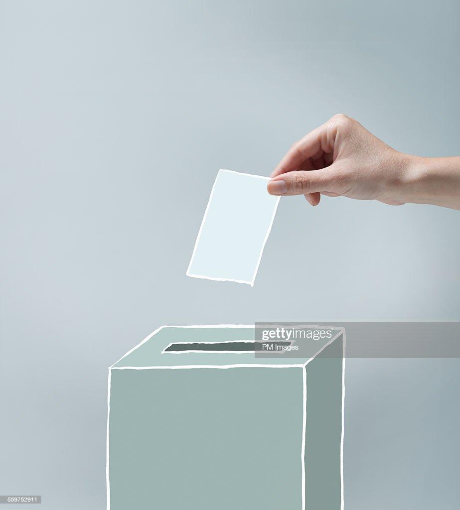 Hand placing ballot : Stock Photo