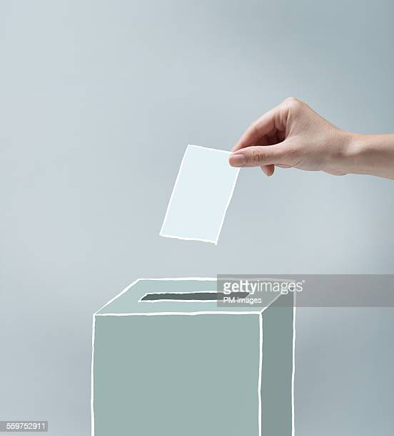 Hand placing ballot