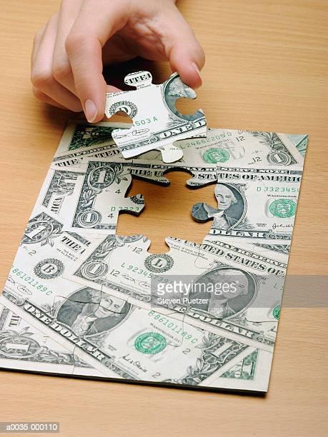 Hand Placing Last Jigsaw Piece