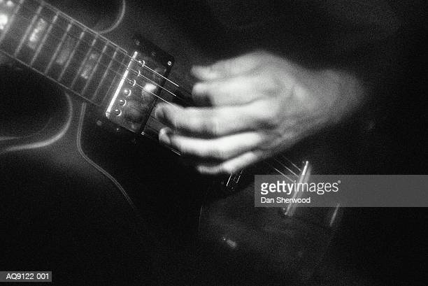 hand playing electric guitar,detail, b&w - dan sherwood photography stock pictures, royalty-free photos & images