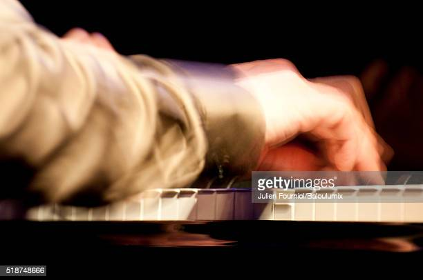 hand playing the piano - jazz club stock pictures, royalty-free photos & images