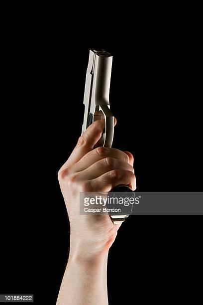 A Hand Pointing A Hand Gun Into The Air