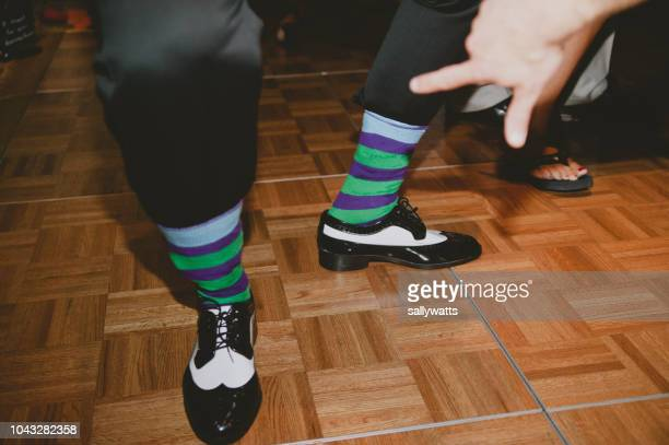 hand pointing at a man's stripy socks on the dance floor - dancing photos et images de collection