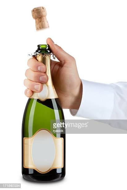 hand popping a cork from generic bottle of champagne - 2012 2013年 キプロス財政危機 stock pictures, royalty-free photos & images