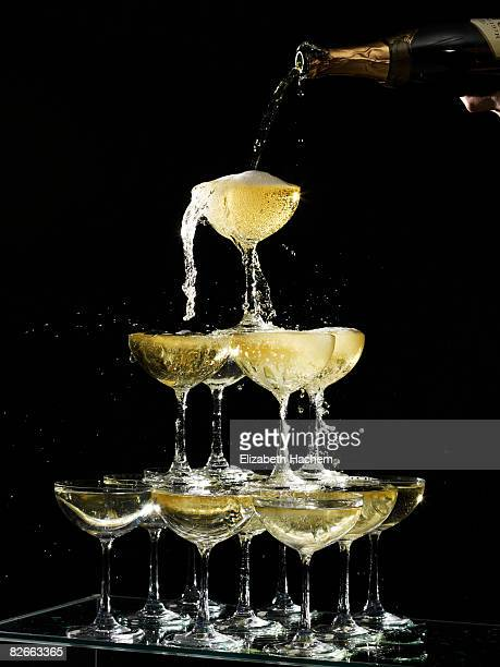 hand pouring a champagne fountain - champagne stock pictures, royalty-free photos & images