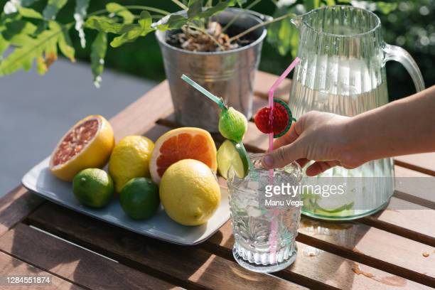 hand preparing a lemonade with grapefruit. stock photo - cocktail party stock pictures, royalty-free photos & images