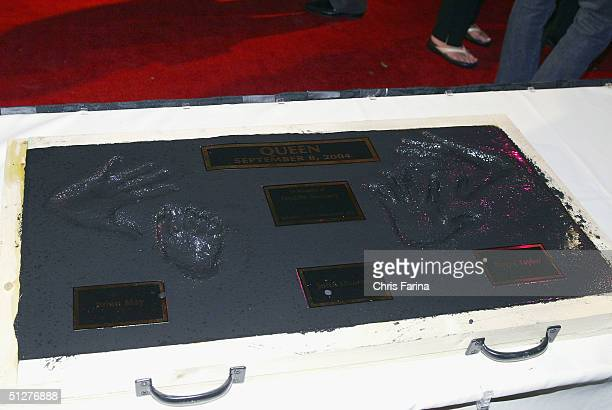 Hand prints of guitarist Brian May and drummer Roger Taylor founding members of the rock group Queen on the special In Memory Of plaque in homage to...