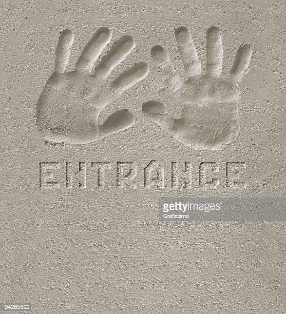 Hand prints on cement  'ENTRANCE'