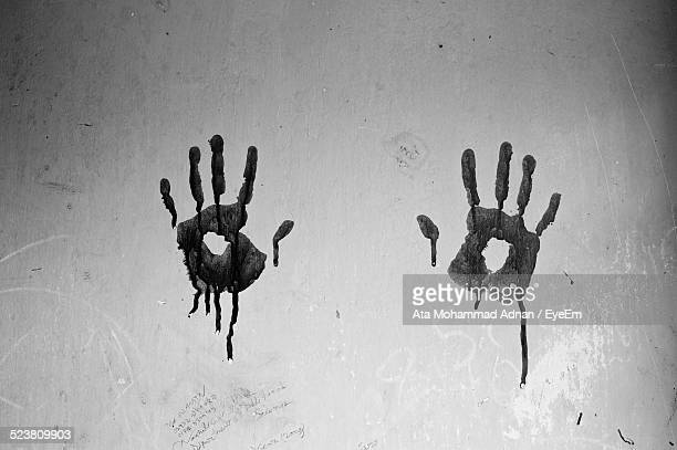 Hand Prints On Wall