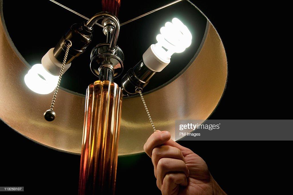 Hand pulling light switch : Stock Photo