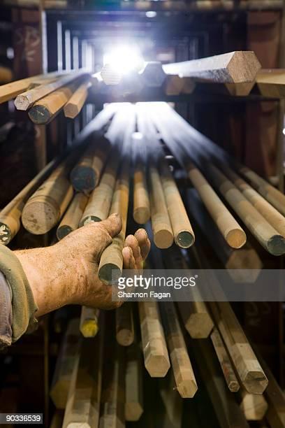 Hand Pulling Soldering Rod From Shelf