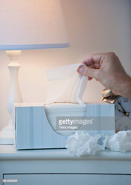 hand pulling tissue out of box - handkerchief stock photos and pictures