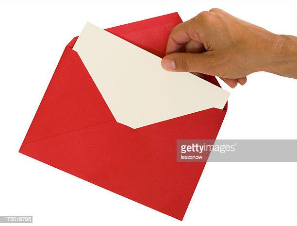 Hand Pulling White Card From Red Envelope