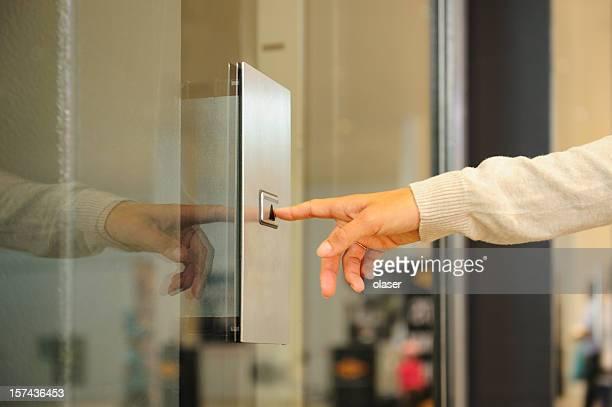 Hand pushing elevator button