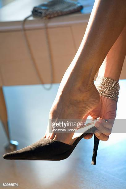 Hand putting on a high heel