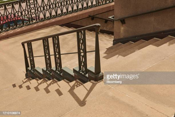 A hand rail casts a shadow on a staircase outside the Cathedral of Saint Joseph in Sioux Falls South Dakota US on Wednesday April 15 2020 South...