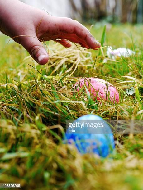 Hand reaching for an Easter egg