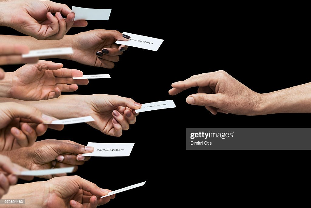 Hand Reaching For One Of Many Business Cards Stock Photo | Getty Images