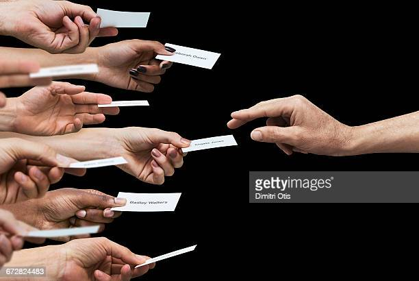 hand reaching for one of many business cards - promotion employment stock pictures, royalty-free photos & images