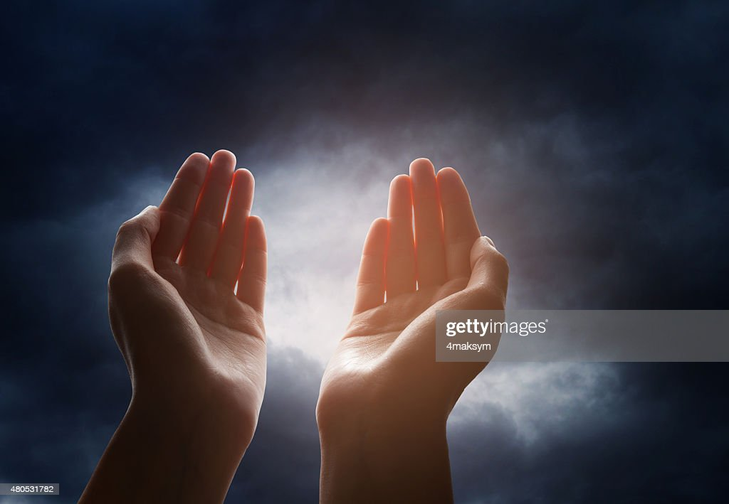 Hand reaching for the cloud in the sky : Stock Photo