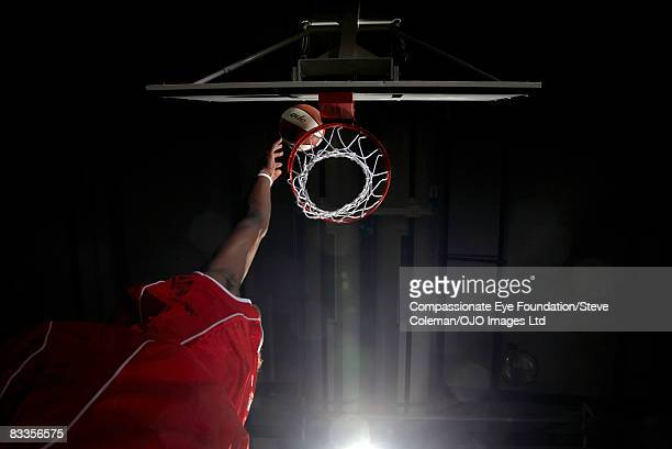 hand reaching high for the basket - making a basket scoring stock photos and pictures