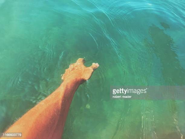 hand reaching into river - water stock pictures, royalty-free photos & images
