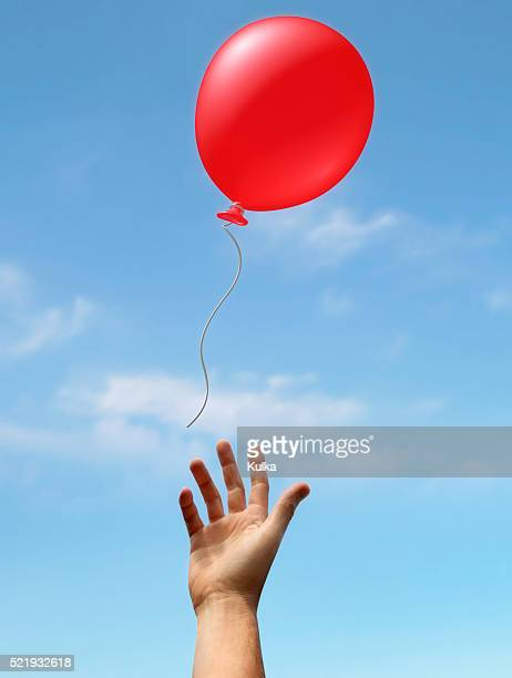 hand reaching up to balloon - releasing stock pictures, royalty-free photos & images