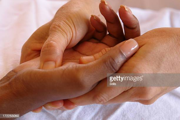 Hand reflexology being performed
