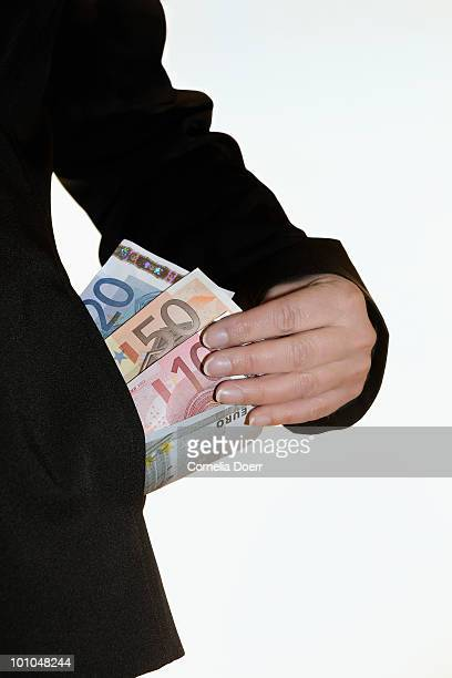 Hand removing money from pocket