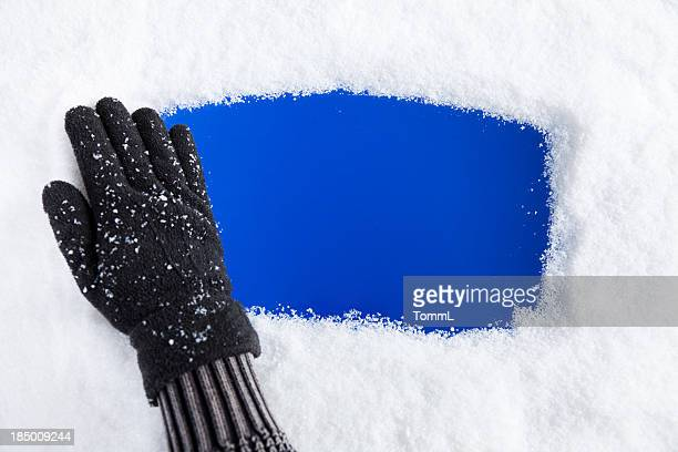 hand removing snow from window - glove stock pictures, royalty-free photos & images