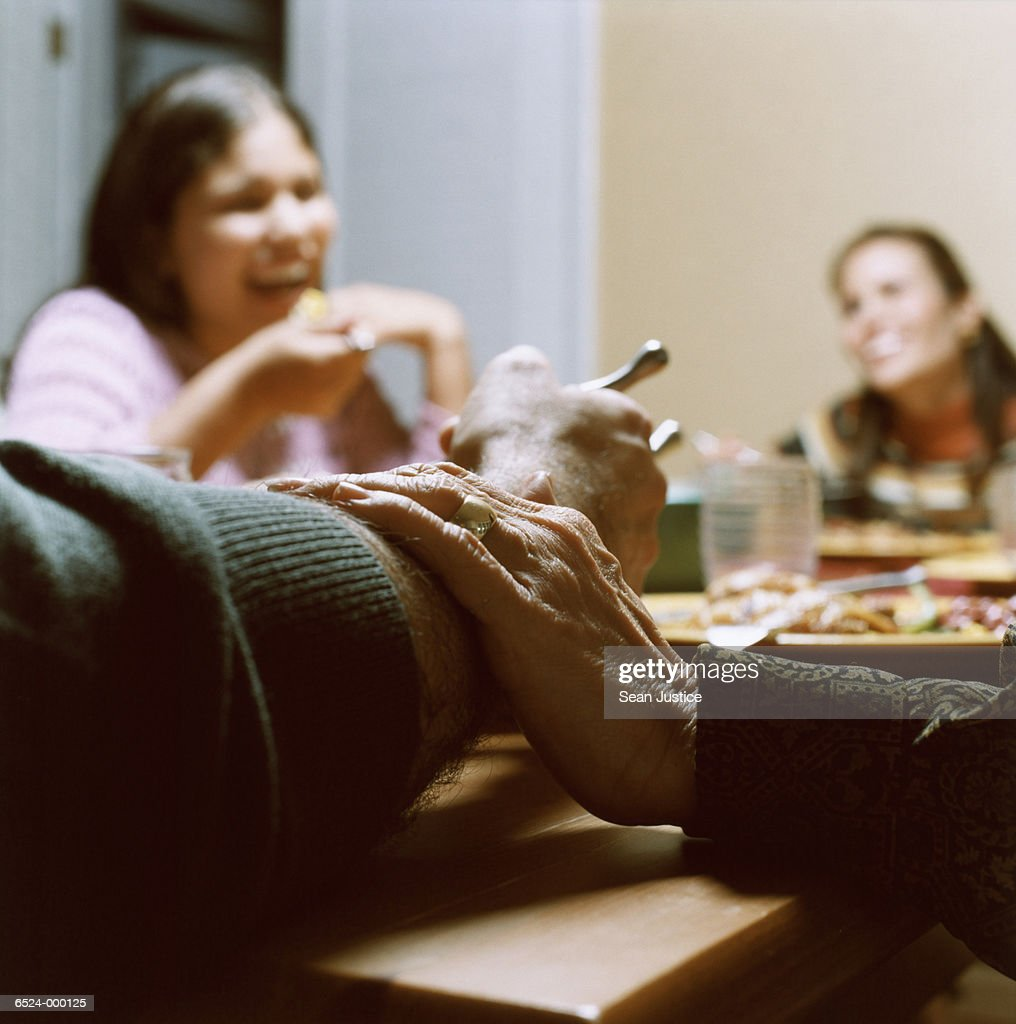 Hand Rests on Arm at Dinner : Stock Photo