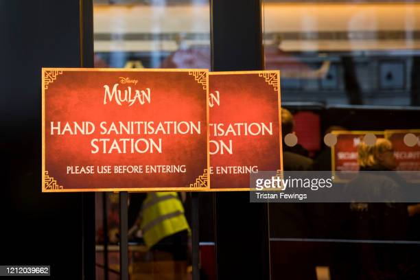 A hand sanitisation sign outside the Mulan European Premiere at Odeon Luxe Leicester Square on March 12 2020 in London England