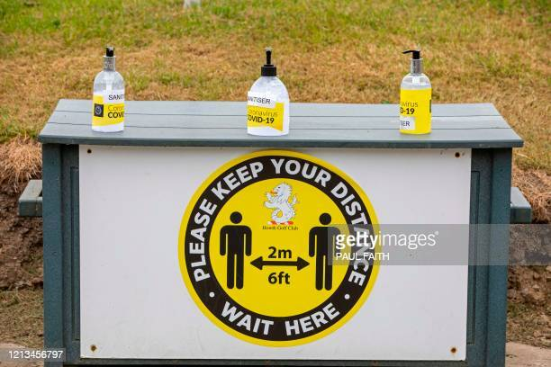 Hand sanitiser and a notice encouraging social distancing are seen at Howth Golf Club in Dublin on May 18 as golf courses reopen and Ireland...