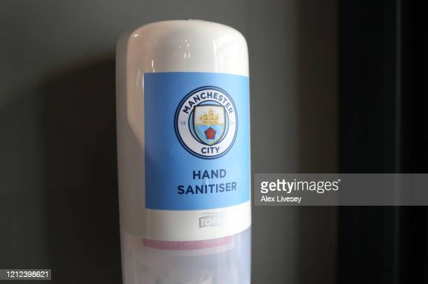 Hand sanitiser is seen inside the club shop at the Etihad Stadium home of Manchester City FC as the scheduled match to be played today between...