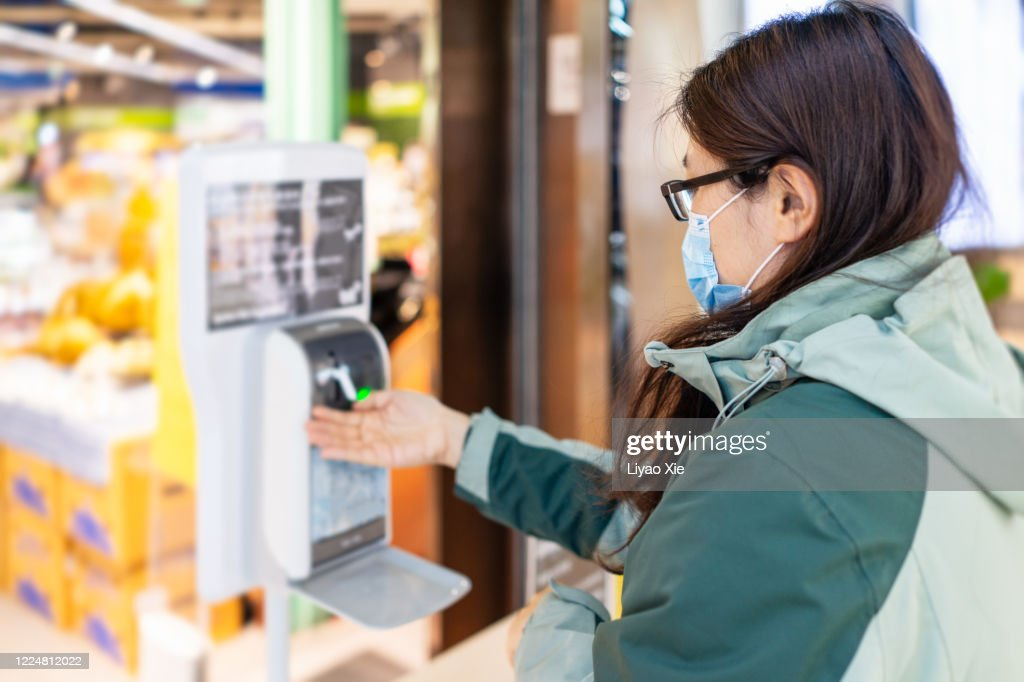 Hand sanitized at entrance : Stock Photo
