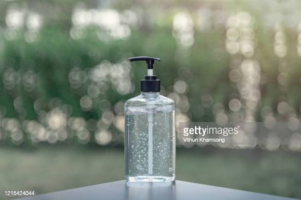 hand sanitizer alcohol gel rub clean hands hygiene prevention of coronavirus virus outbreak.people using bottle of antibacterial sanitiser soap. - rubbing alcohol stock pictures, royalty-free photos & images