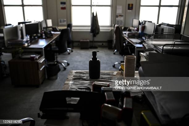 Hand sanitizer bottle is displayed on a desk at an empty open-space, which has been closed due to Covid-19 cases, at the business district of La...