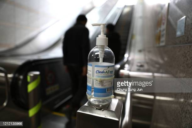 Hand Sanitizer is seen at the escalator on March 13 2020 in Seoul South Korea According to the Korea Center for Disease Control and Prevention 110...