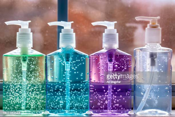 hand sanitizer line up - hand sanitizer stock pictures, royalty-free photos & images