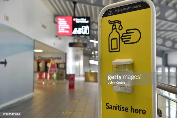 Hand sanitizer station as London Southend airport prepares for the reintroduction of passenger flights on June 18, 2020 in Southend-on-Sea, England....