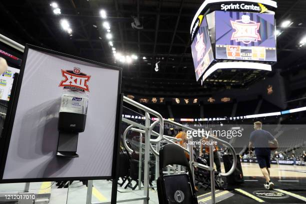 A hand sanitizer station sits courtside prior to the Big 12 quarterfinal games at the Sprint Center on March 12 2020 in Kansas City Missouri