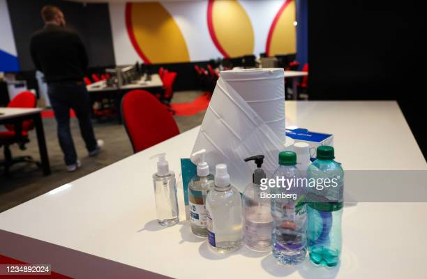 Hand sanitizer, tissues and antibacterial spray on a desk in the offices of a branch of Metro Bank Plc in London, U.K., on Thursday, Aug. 26, 2021....