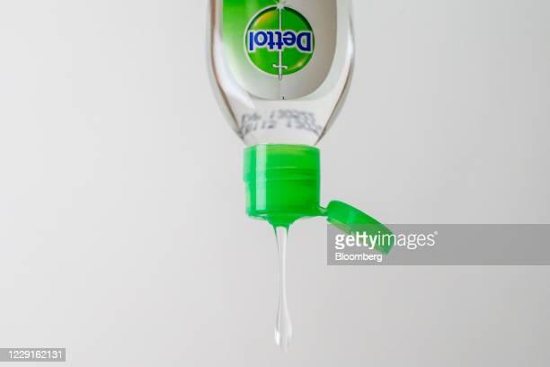 Hand sanitizing gel falls from a Dettol hand sanitiser bottle, produced by Reckitt Benckiser Group Plc, in an arranged photograph in London, U.K., on...