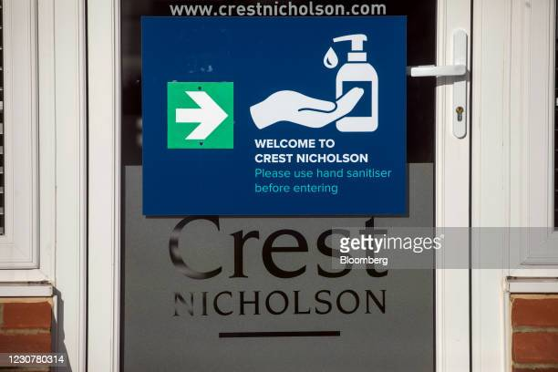 Hand sanitizing sign at the entrance to the show home on a Crest Nicholson Holdings Plc new housing development in Tiptree, U.K., on Thursday, Jan....