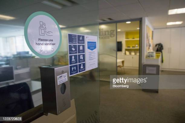 A hand sanitizing station sits on the wall at offices in London UK on Wednesday June 24 2020 Companies are getting ready to welcome more staff back...