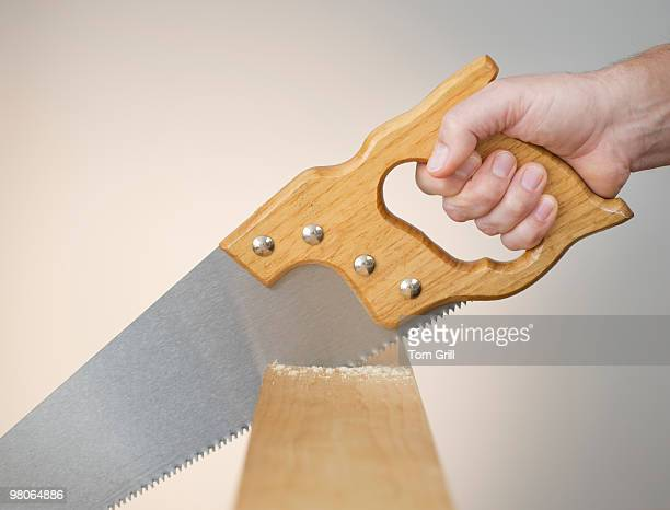 Hand sawing wood