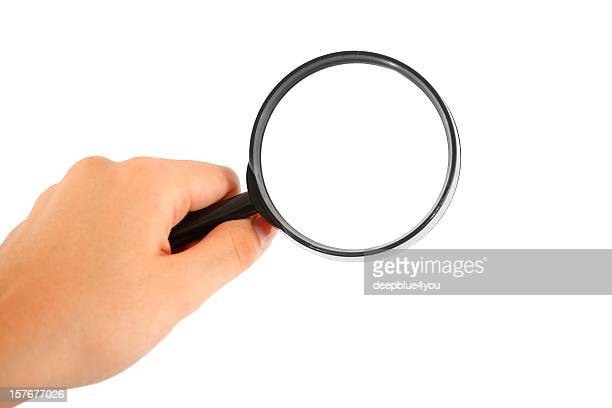 hand searching with magnifying glass on white