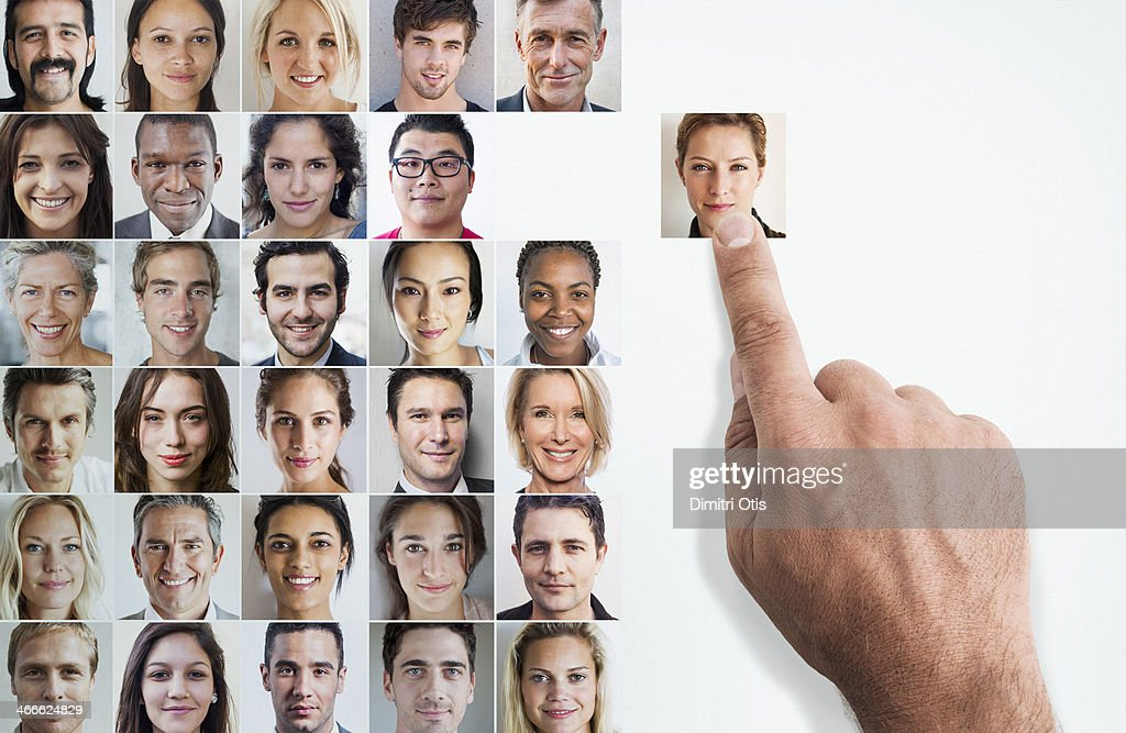 Hand selecting woman's portrait amongst grid : Stock Photo